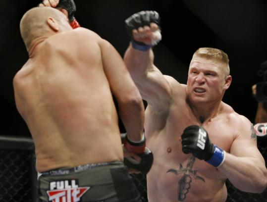 Brock Lesnar punches Couture