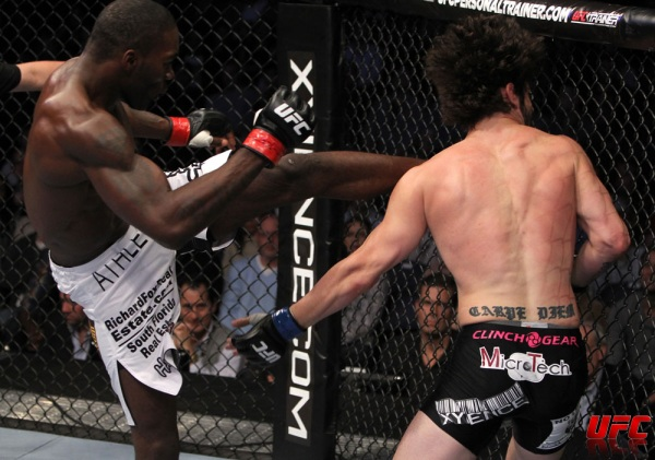 Anthony Johnson kicks Brenneman