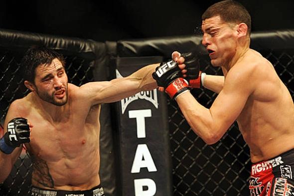 Condit punches Diaz UFC 143 photo