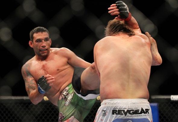 Werdum kicks Nelson UFC 143 Photo